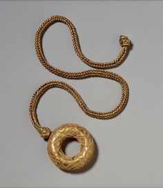 Circular Pendant on a Chain, Etruscan, 7th century B.C. | The Walters Art Museum