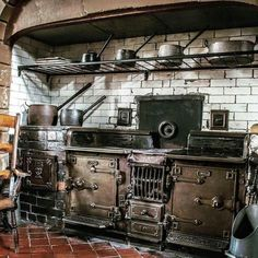 This Gothic kitchen is very rustic. It has old, dark, rustic appliances that fit this type of house very well. It has got rustic white bricks. Wood Burning Cook Stove, Wood Stove Cooking, Kitchen Stove, Old Kitchen, Rustic Kitchen, Vintage Kitchen, Kitchen Cabinets, Tv Cabinets, Steampunk Kitchen