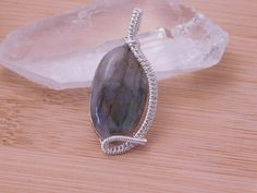 Labradorite Grooved Cabochon in Sterling Silver Wire Pendant Wire Wrapped Jewelry Medallion Scifi Some Blue Flash Fantasy Amulet by OurFrontYard on Etsy https://www.etsy.com/listing/484605196/labradorite-grooved-cabochon-in-sterling