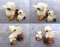 Mama and Baby Gryphon by DragonsAndBeasties on deviantART