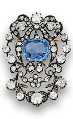 An important Belle Epoque gold, silver, diamond and Ceylon sapphire brooch, circa 1900. 6 x 4.4cm.