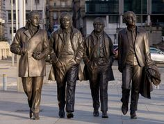 A New Statue of The Beatles by sculptor Andy Edwards is unveiled at Pier Head on December 4, 2015 in Liverpool, England. The bronze sculpture was donated to the city by the Cavern Club and unveiled by John Lennon's sister Julia Baird. (Photo by Richard Stonehouse/Getty Images)