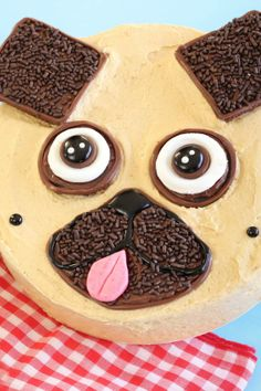 Graham cracker ears, chocolate candy eyes and a fruit taffy tongue make this peanut butter-covered pup cute as can be. If you're serving a crowd, bake up an extra batch of Betty Crocker Reese's peanut butter and chocolate cupcakes and serve alongside the pooch.