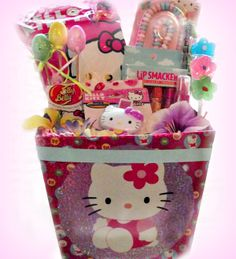"It's ""Hello Kitty"" all dressed up for Spring! The gift box is decorated in foil ""Hello Kitty"" decor on all 4 sides.  Treats include a bag of ""Hello Kitty"" Cotton Candy, ""Hello Kitty"" Jelly Belly jelly beans, ""Hello Kitty"" edible ""jewelry"", ""Hello Kitty"" flavored lip gloss, a travel-size ""Hello Kitty"" body spray, a 3-pack of Lip Smackers flavored lip balm, flower-shaped lollipops and a colorful swirly lollipop! A great gift for any ""Hello Kitty"" fan!"