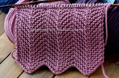 Knit Zig Zag Stitch Featured Image - Watch this free video tutorial with English subtitles to learn how to knit zig zag stitch or chevron pattern. This gorgeous pattern is so useful for many knitting projects.