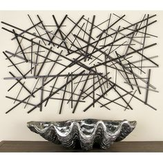 Modern reflections Metal Wall Décor, rectangular-shaped decor, polished iron rods of varying length in dark gray finish arranged in an abstract pattern.