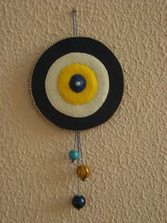 DUVAR SÜSÜ NAZARLIK Felt Crafts, Diy And Crafts, Arts And Crafts, Evil Eye Art, Diy Bead Embroidery, Wall Ornaments, Decoration Piece, Felt Decorations, Art N Craft