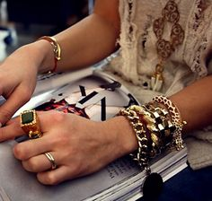 """The grown-up """"arm party"""": Pay attention to color. This fashionista is wearing an (almost) monochromatic stack."""