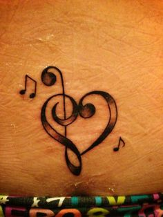 Love the extreme detail!! Treble & bass clef heart tattoo