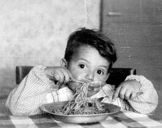 A little Italian boy and his bowl of spaghetti.
