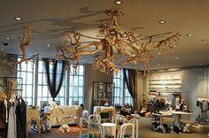"""Tree root"" ceiling installation at retail space Takashimaya. Sandblasted grapevine artfully formed into 16-ft diameter ""tree root"". Very Tim Burton-esque feel. Fabulous."