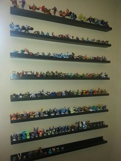 SKYLANDERS Display- Perfect shelves are RIBBA picture frame shelves from IKEA ! Yes, My Son, Liam has a TON of them. and why I wanted to get them organized, easily accessible for him. and they make a great display in the gameroom! Picture Frame Shelves, Frame Shelf, Glass Shelves Ikea, Display Shelves, Display Ideas, Amiibo Display, Boy Room, Kids Room, Avengers Room