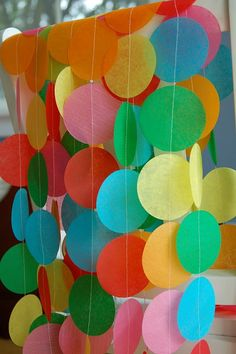 Etsy - Rainbow Tissue Garland. This could be a cute decoration for their party, done in Very Hungry Caterpillar colors. drkmok