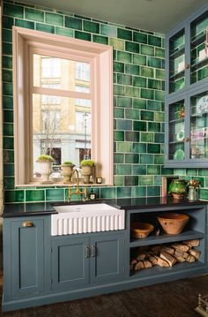 A wonderful sink area, with bespoke cupboards and handmade green metro tiles