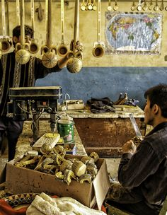 Hand made musical instruments inside a small workshop in Kashgar.