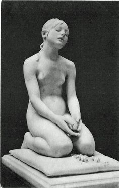 sculpture of a girl kneeling