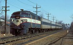 LIRR Alco FA-1 #604 pulling P72 passenger cars Westbound. Blue and white/red stripe MTA paint scheme (1st repaint)