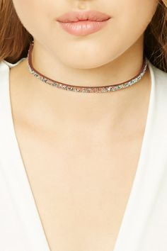 A skinny faux leather choker necklace featuring a sequin design, high-polish finish, and a lobster clasp closure.