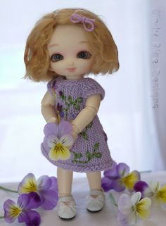 """""""Sweet Li'l Viola"""", a limited edition hand knit and embroidered dress for Fairyland's Pukipuki dolls.  Inspired by the violas (johnny-jump ups) growing in my garden.  cindyricedesigns.com"""