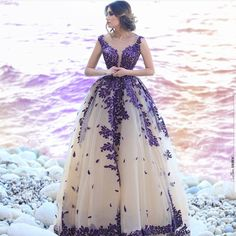 This #purple colored formal dress is great for a #bride looking for something unique and different. Have custom #weddingdresses made with any design preferences in mind. We also specialize in making #replicas of couture #dresses too.