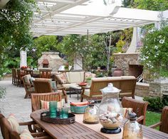 The spacious patio makes entertaining large gatherings of family and friends easy. Outdoor lighting also plays a vital role in keeping the party going well into the night. Downlights in the arbor are grouped by zone and fitted with dimmers, defining rooms within rooms. Plantings, stone lanterns, and a fountain at the yard's edge are softly lit, as well.