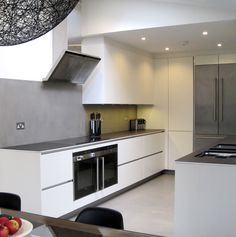 Funktional Kitchens have just fitted this Muswell Hill kitchen with handleless satin lacquer units, a slim profile ceramic worktop and an american fridge freezer with cantilevered doors, to enable a flush, streamline fit.
