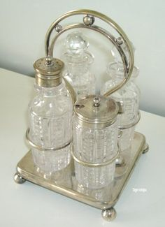 Possibly old english cut glass condiment set, Silver plate is marked Zetna Silver