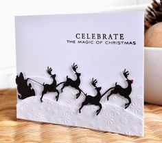 handmade card from Inky Fingers ... die cut scene ... Santa and reindeer ... snow drifs with embossing folder little snowflakes ... black and white ... quite bright ... graphic appeal ...