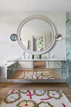 """[i]A mirror from [link url=""""http://www.aandlantiques.co.uk/""""]A & L Antiques[/link] and a mirrored vanity unit increase the feeling of space in the en suite bathroom.[/i]  Like this? Then you'll love  [link url=""""http://www.houseandgarden.co.uk/interiors/real-homes/luke-edward-hall-flat""""]The London flat of Luke Edward Hall and Duncan Campbell[/link][link url=""""http://www.houseandgarden.co.uk/the-list""""][/link]"""