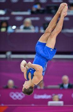 During Team USA's men's gymnastics Olympic qualifying in London, Jake Dalton tumbles on floor exercise.