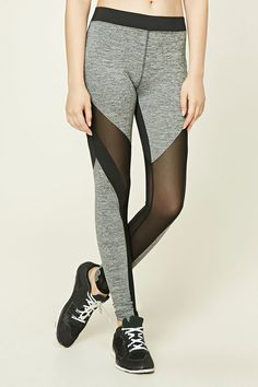 A pair of marled knit athletic leggings featuring mesh panels, elasticized waist, and moisture management.