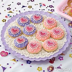 Share the love with heart cookies! Follow our Sofia the First Court of Cookies decorating tips to makes these treats!