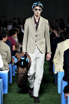 See the complete Prada Spring 2012 Menswear collection.