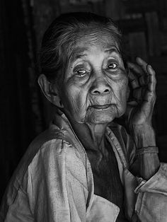 Madame from Baduy Tribe - Indonesia. Old woman, hand, fingers, wrinckles, lines of life, beauty, cracks in time, powerful face, intense eyes, portrait, photo b/w.