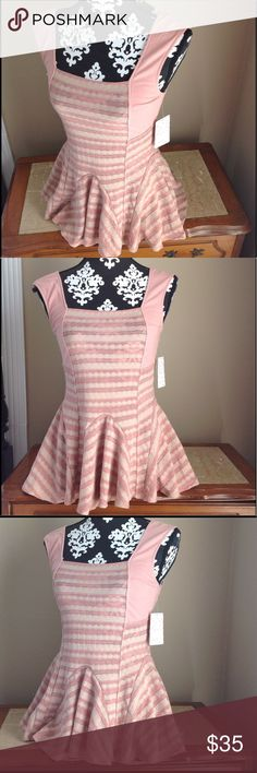 """Free People top NWT blouse sleeveless size xs Free People top. Size extra small. NWT. Armpit to armpit measures about 14.5"""" laying flat.Toast comb color.Sleeveless. Please look at all pictures before you purchase. And ask any questions. Thanks! Free People Tops Blouses"""