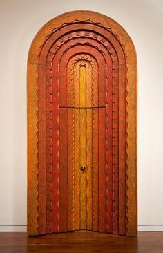 Door and Surround, 1967, Phil Phillip Lloyd Powell (1919-2008) // Softwoods carved in various designs, stacked and painted in shades of yellow, orange and red // Putman-Smith Gallery at the James A. Michener Art Museum.