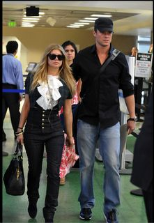 """Fergie (Black Eyed Peas) is off her honeymoon much has been said about the """"HIGH WAISTED JEANS THAT SHE IS WEARING"""" These great designer jeans are made by The New York designer MAXIME COSSOGUY. The line is name MAXIME COSSOGUY (drowning in my sleep)  The high waisted jeans with five beautiful gold buttons front reaching all the way up below her breasts. The fit is perfect and the fabric and details unbelievable."""