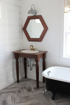 One way that we saved money on this bathroom was by building our own farmhouse table vanities.  If you missed the post about why we chose this style and some in-progress bath shots, you can check that out here.  Getting these vanities finished and installed is making this bath finally come together! I'm excited to …