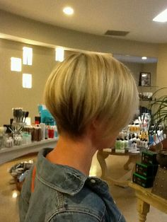 Undercut pretty short all the way around. Haircut and hilites by me.