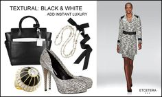 "Textural black and white add instant luxury; Etcetera hits the mark with the ""Herald"" topper and skirt."