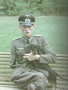 A GERMAN OFFICER WITH HIS DOG
