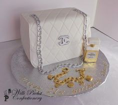 Chanel handbag themed birthday cake with fondant accessories