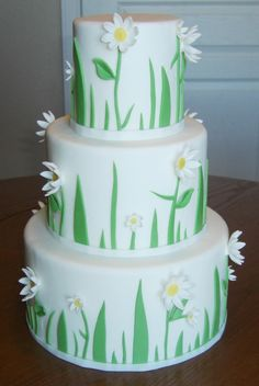 Cake dummies covered in fondant.  Grass and Daisy's also fondant.