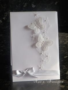 handmade card from Bodhicea's Designs: White Vellum Butterfly Card  ... delightful white on white ... cloud of butterflies rising to the skies .. pearls and satin ribbon ... luv it!!