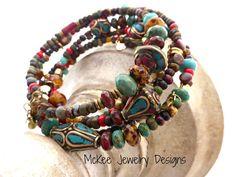 Czech Picasso glass, brass, and stone. Tibetan wrap around memory wire bracelet