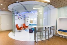 Healthcare Everything is custom made in the teen room. The funnel or petal-shaped ceiling is backlit with recessed lighting and color-changing LED strips. #healthcare design