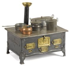 French tin and brass toy stove, 6 3/4'' h., 13 1/4