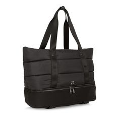 """LOVED FOR: Its lightweightfabric and storage compartmentsUSERS SAID: """"As a yoga teacher I spend my days schlepping all over NYC. This bag fits everything I need, including a space for my mat, and lined pockets for my toiletries. I love the design and feel chic walking around the city with my bag!"""""""