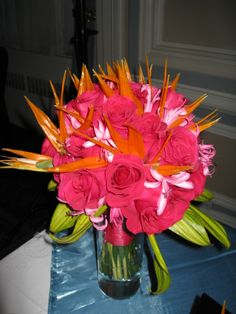 Add a tropical flare to your reception - hot pink roses, birds of paradise and nerine lilies