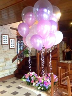 Customised arrangements with balloon-inside-a-balloon in lavendar and pink tied to matching flowers
